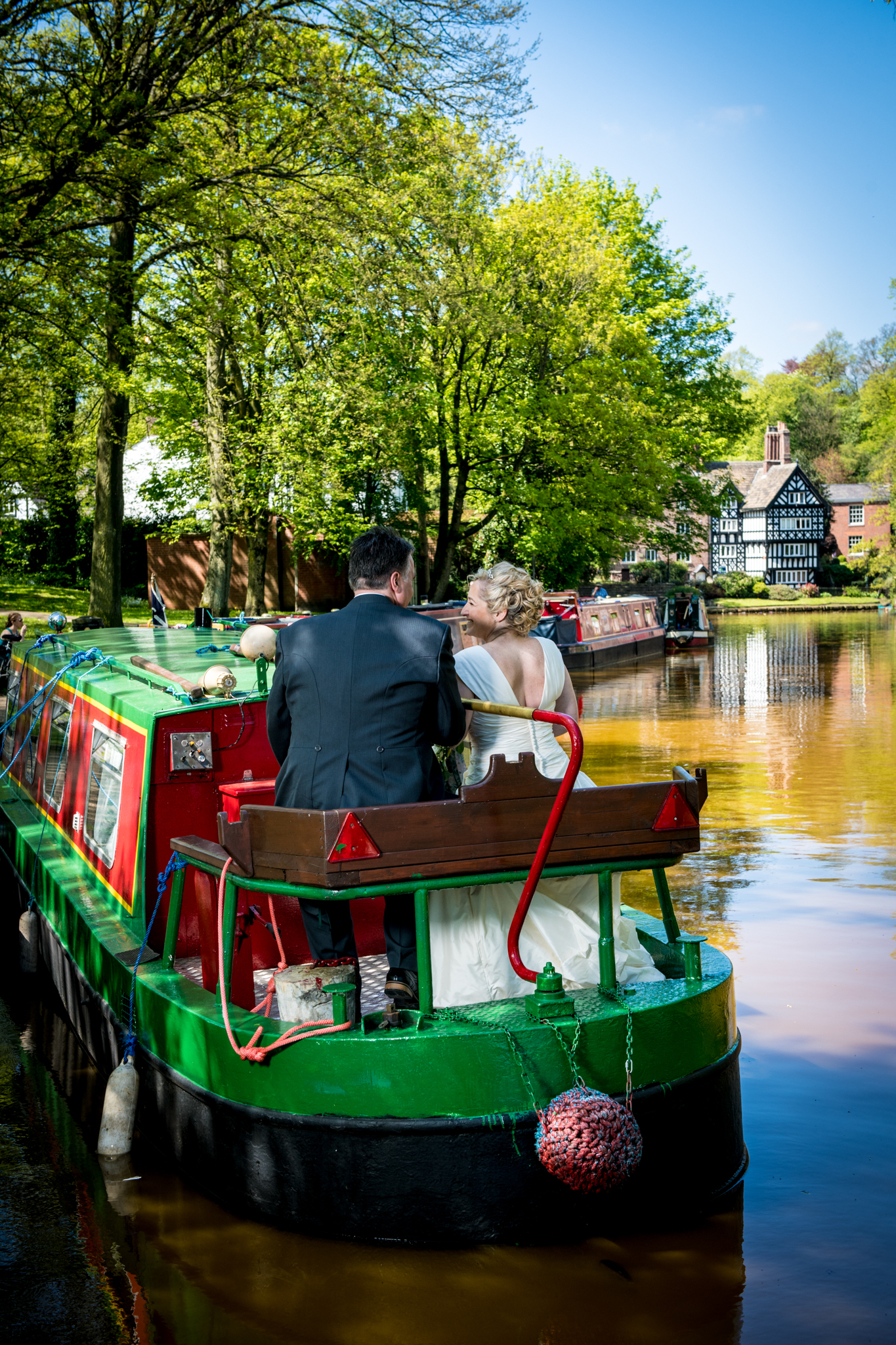 Bride and Groom on narrow boat Worsley